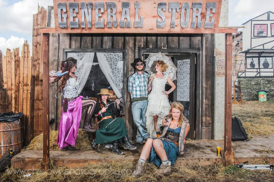 Boomtown photo - A group of festival goers outside the old west general store