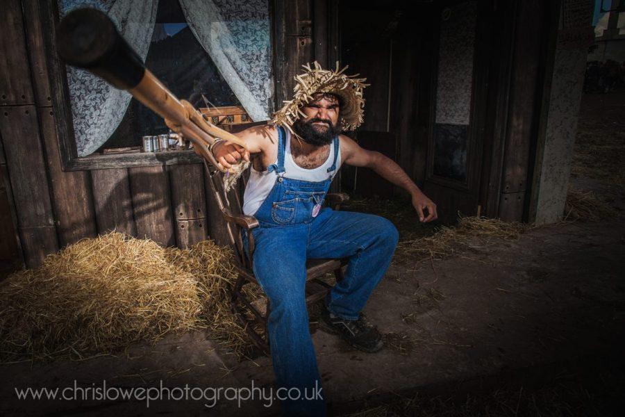 Boomtown Photo - Old west man wielding crutch
