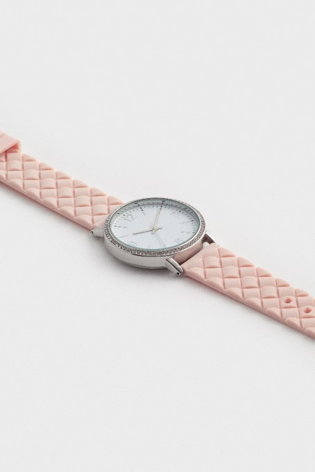 An example of a standard product shot; one of the simplest types of product photography. This example shows a watch photographed at an angle on a plain background.