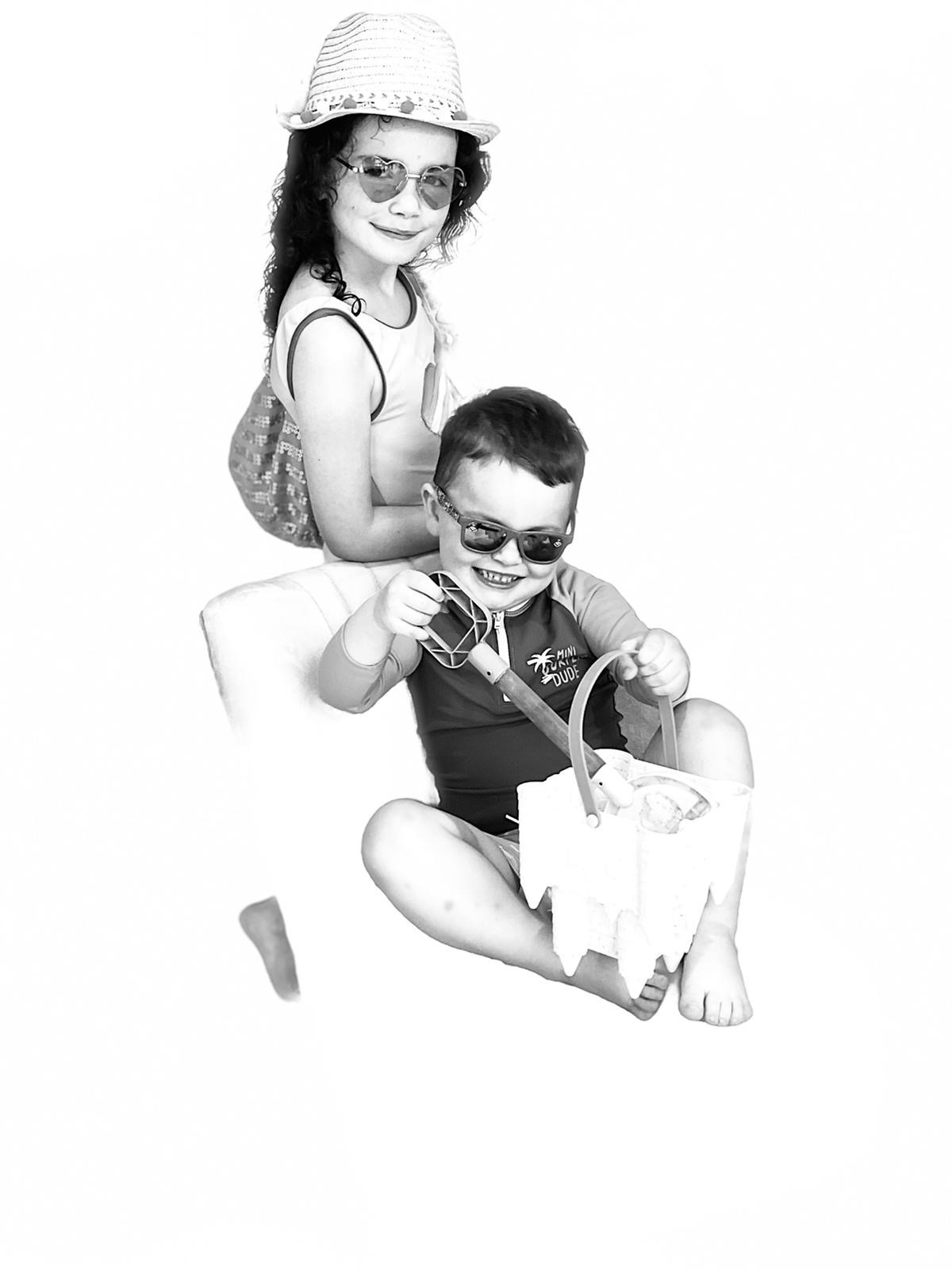 Ciara's submission to the Great British Photography Challenge shows her children, Ellie and Donovan, in beach gear in black and white.