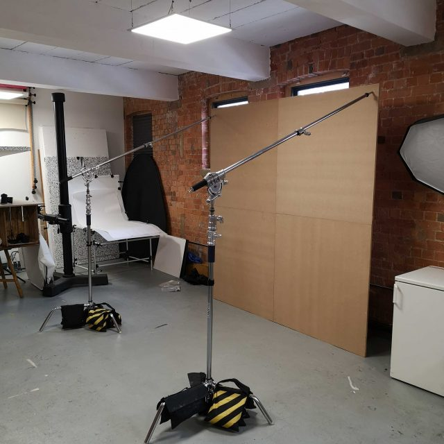 A behind the scenes shot from a creative still life shoot; Amelia was shoot assistant. This shot shows a newly-created wall made of plywood.