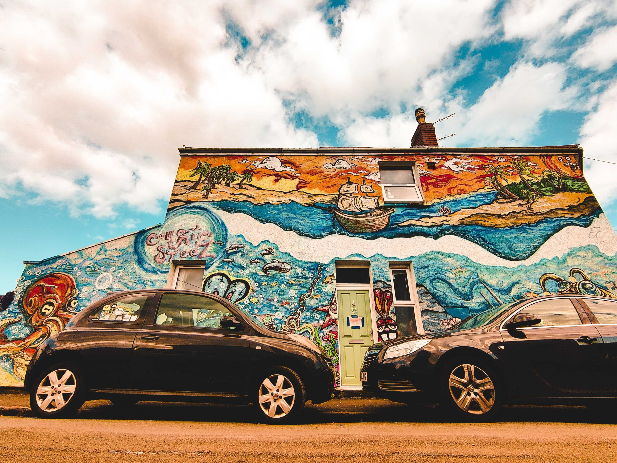 Lucas' submission to the Great British Photography Challenge shows the side of a house that's been painted to show a beach scene. The scene includes the sea, palm trees, an octopus and a pirate ship.